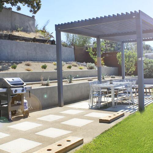 Hillside perfect pergola, painted wood pergola, outdoor dining area, garden walls