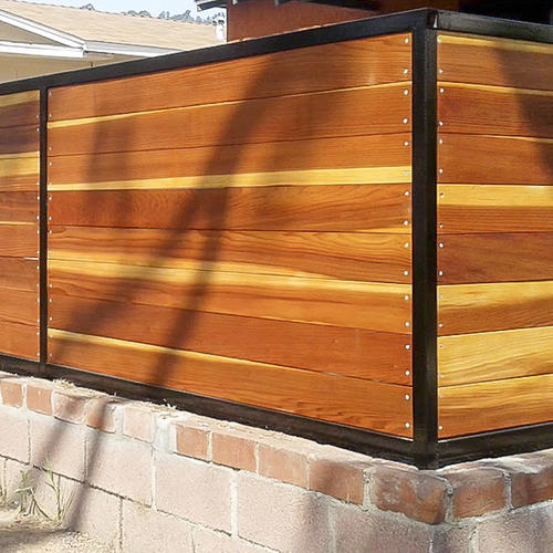 Redwood front yard fence with metal trim